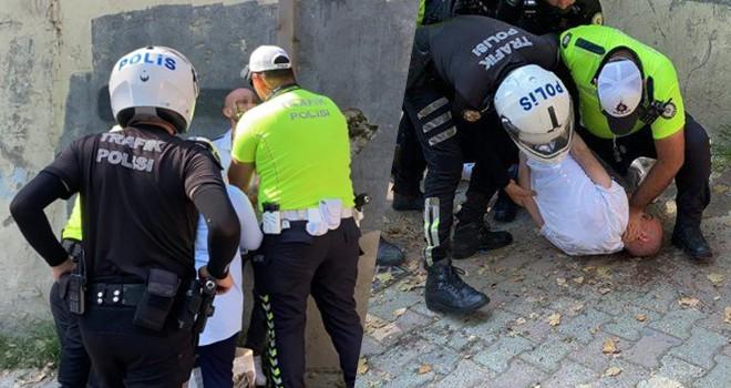 Sinir krizi geçirip polisin silahını almaya çalıştı