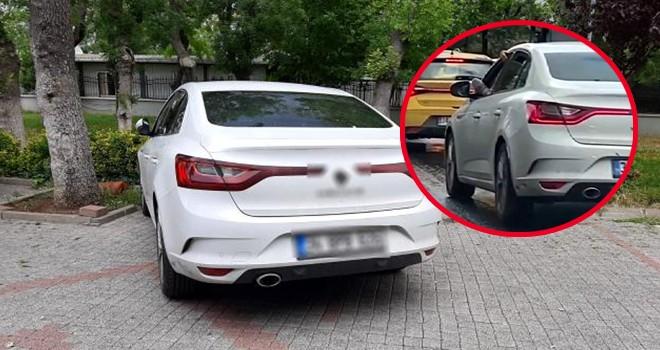 Ayağını camdan çıkararak otomobil kullanan sürücü gözaltında
